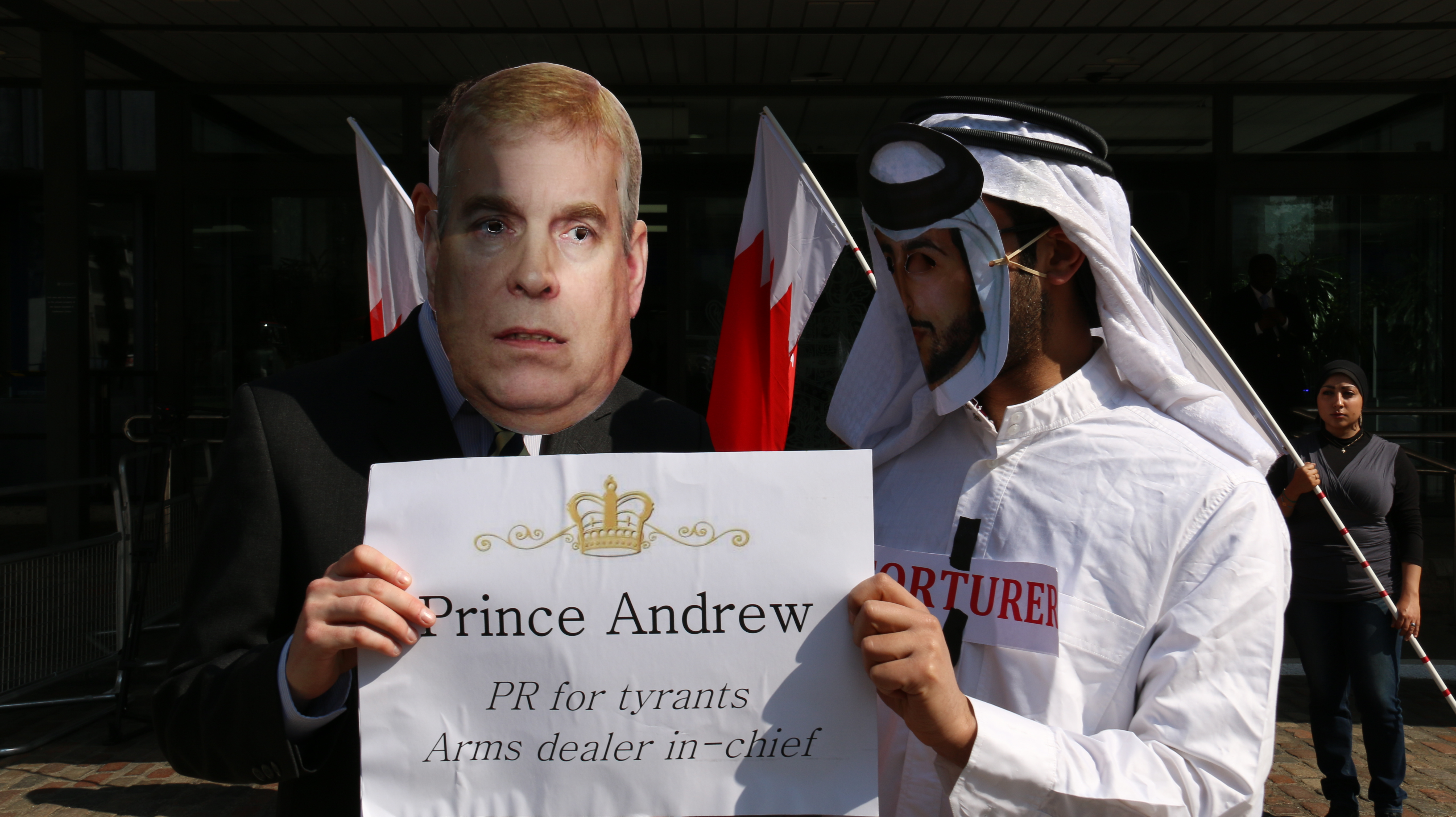During the protests, activists wore masks of Prince Andrew and Nasser Bin Hamad and acted out a citizens arrest on the figure dressed as Nasser