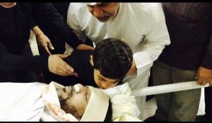 Mohammad Sahwan's son, at the funeral of his father.